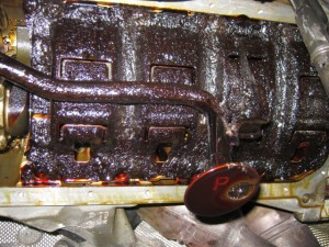 The engine sump (bottom), covered in carbonised oil